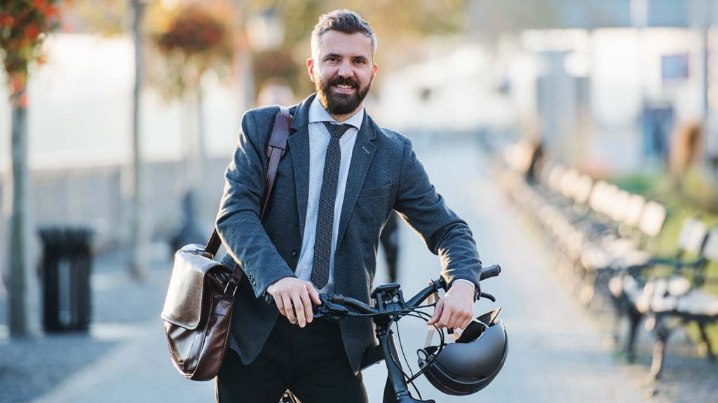 businessman-commuter-with-bicycle-walking-home-RDKSJ3E-copy